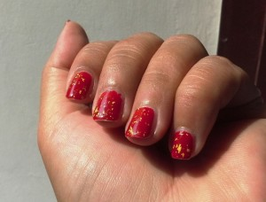 Zoya Gilty (gold flakes) over a 5-day manicure of OPI Over & Over A-Gwen